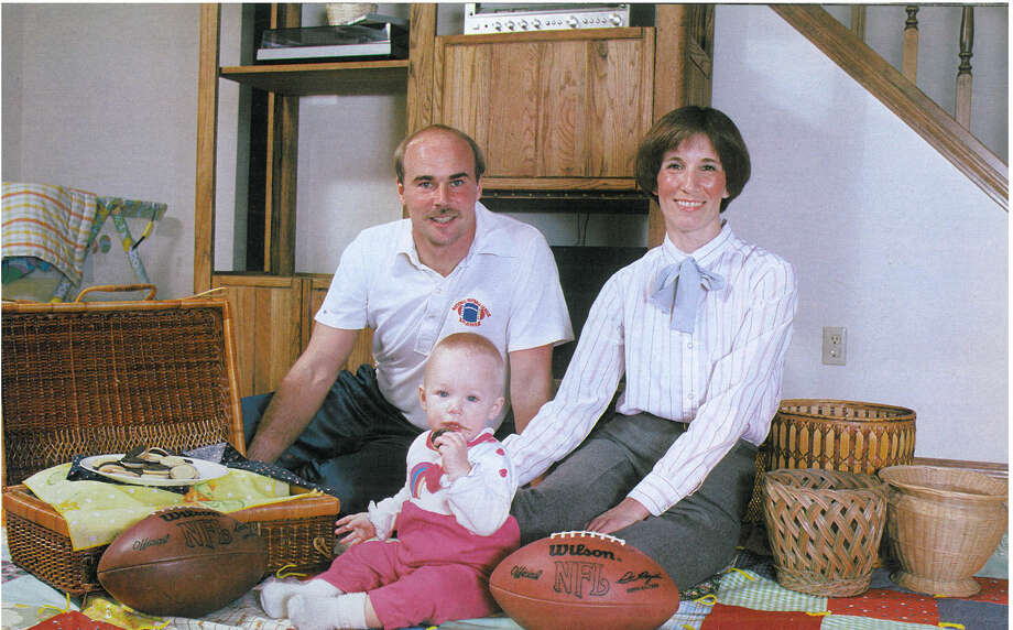 Punter Jeff West is pictured with his wife, Kathy, and their toddler. Photo: Corky Trewin/Seattle Seahawks