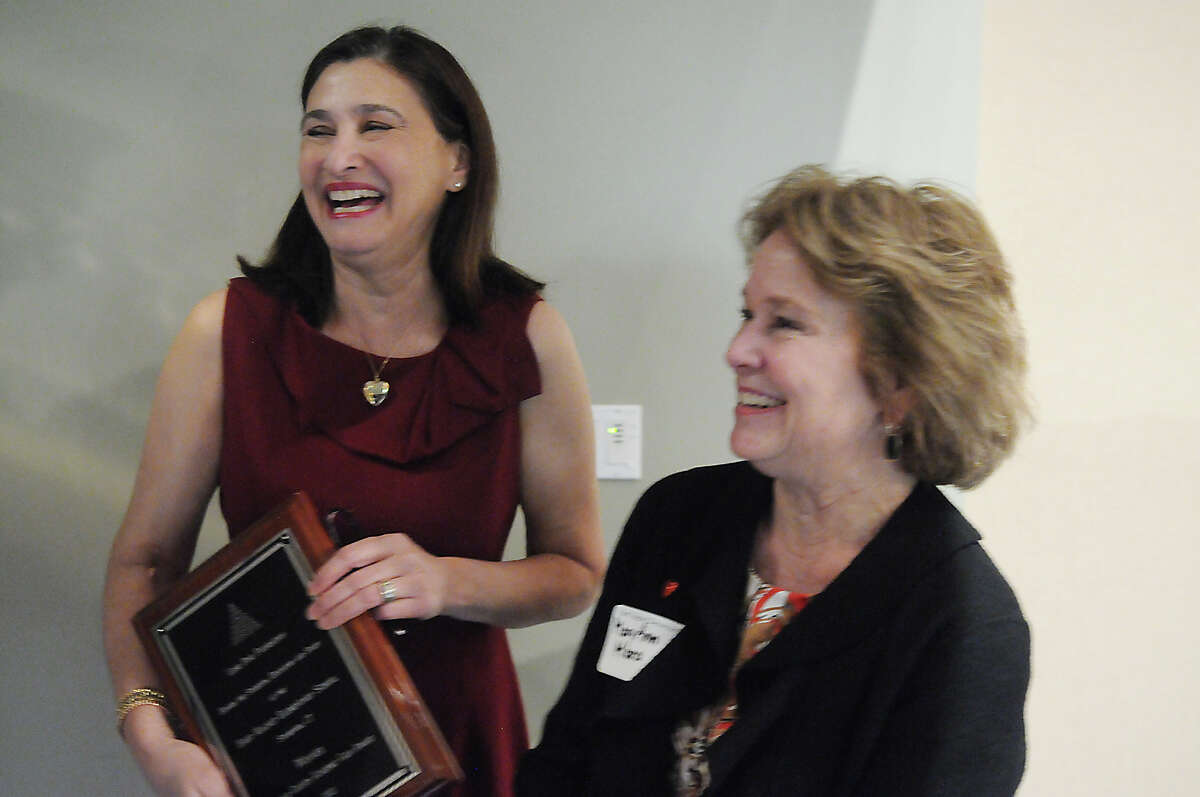 Hart Magnet Elementary School's Linda Darling and MaryAnn Mara, right, bask in the afterglow of winning the coveted Lone Pine Foundation's Gain Award during a ceremony at UCONN Stamford GenRE Auditorium in Stamford, Conn., Nov. 21, 2013.