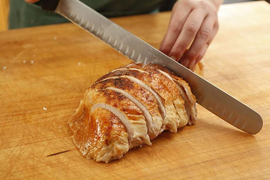Slicing a breast into steaks of a Bestway air dried turkey. Photo: Craig Lee, Special To The Chronicle