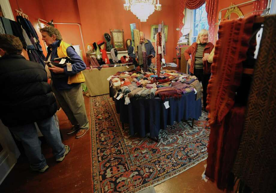 People look at hand made items for sale at the Hudson-Mohawk Weavers' Guild 35th Annual Show & Sale at the Pruyn House on Thursday, Nov. 21, 2013 in Colonie, N.Y. The event is free an open to the public through Sunday. (Lori Van Buren / Times Union) Photo: Lori Van Buren / 00024694A