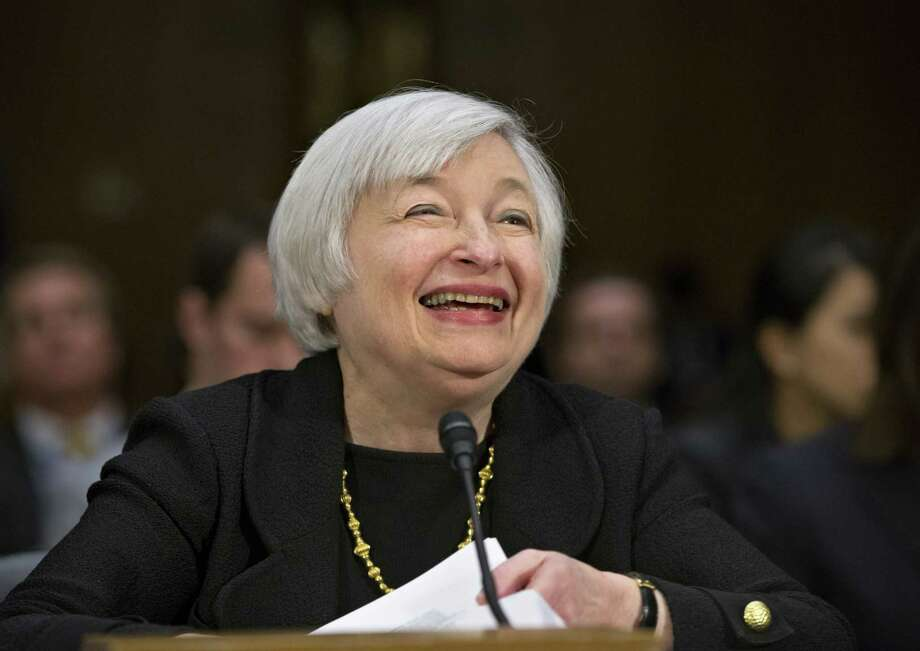 Janet Yellen may have reason to smile, as a Senate panel on Thursday advanced her nomination to succeed Ben Bernanke and lead the Federal Reserve. Photo: J. Scott Applewhite / Associated Press