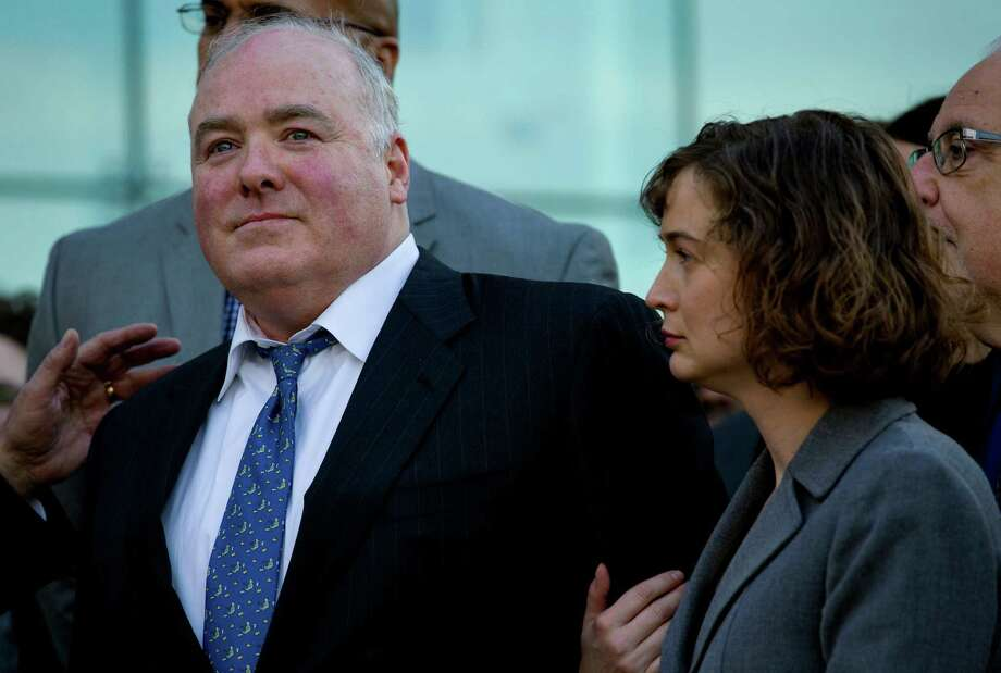 Michael Skakel, accused in the 1975 slaying of neighbor Martha Moxley, stands outside Stamford Superior Court in Stamford, Conn. Thursday, Nov. 21, 2013, after being released following a hearing. Right is attorney Jessica Santos. Skakel, the 53-year-old nephew of Robert F. Kennedy's widow, Ethel Kennedy, who has served 11 years of a 20 years to life sentence, will remain free awaiting a new trial. (AP Photo/Craig Ruttle) Photo: Craig Ruttle, FRE / FR61802 AP