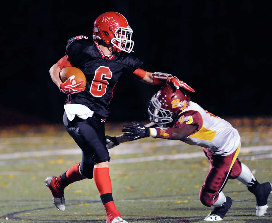 New Canaan WR Teddy Bossidy (6) jukes a St. Joseph defender after a reception during a lopsided win by the Rams on Nov. 1. The teams meet again Friday for the FCIAC championship. Photo: Bob Luckey / Greenwich Time