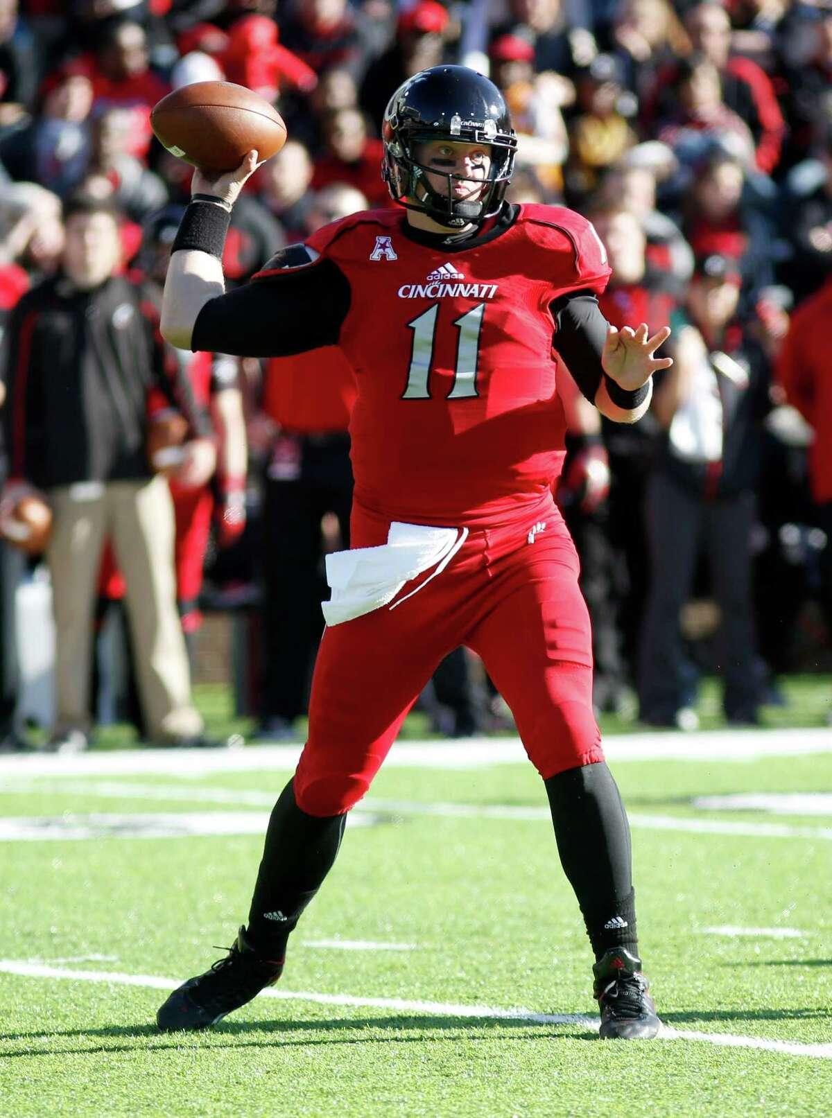 Cincinnati quarterback Brendon Kay throws against SMU during an NCAA college football game, Saturday, Nov. 9, 2013, in Cincinnati. (AP Photo/David Kohl)