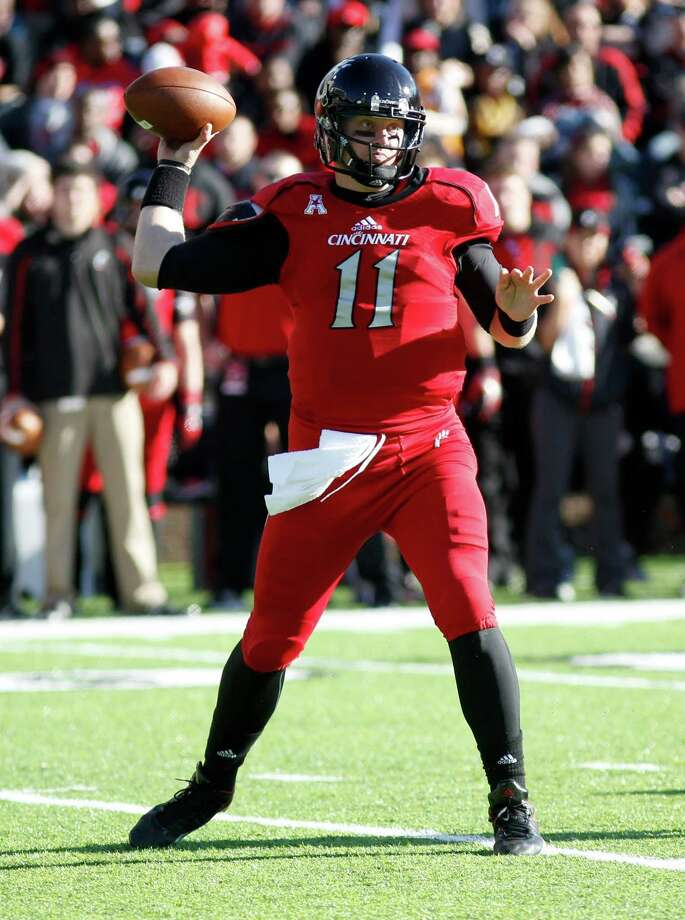 Cincinnati quarterback Brendon Kay throws against SMU during an NCAA college football game, Saturday, Nov. 9, 2013, in Cincinnati. (AP Photo/David Kohl) Photo: David Kohl, Associated Press / FR51830 AP