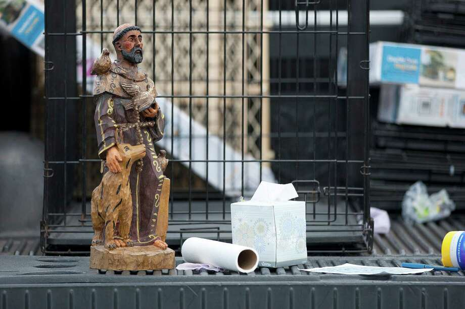 A statuette of Saint Francis sits on the bed of a truck as more than 50 dogs from BARC were shipped to local shelters in Colorado as BARC, the City of Houston animal shelter and adoption facility, and the group Rescued Pets Movement launched a new transportation program to ship the growing number of unwanted dogs from Houston to shelters in need Thursday, Nov. 21, 2013, in Houston. 
