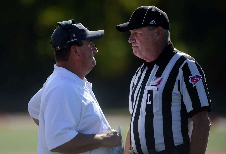 Sacred Heart coach Mark Nofri confers with a ref during their game against Central Connecticut at Campus Field on Sacred Heart University's campus Saturday, Oct. 12, 2013 in Fairfield, Conn. Photo: Autumn Driscoll / Connecticut Post