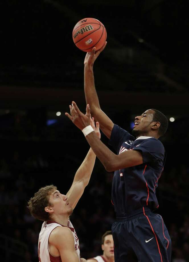 Connecticut's DeAndre Daniels, right, shoots over Boston College's Eddie Odio during the first half of an NCAA college basketball game on Thursday, Nov. 21, 2013, in New York. Photo: Seth Wenig, AP / Associated Press