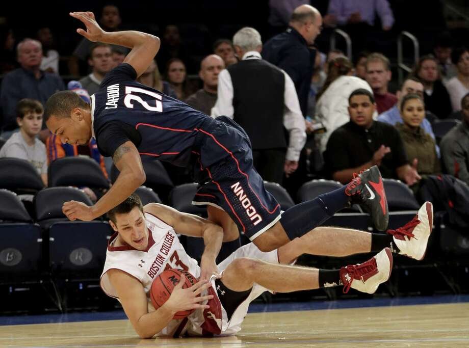 Boston College's Alex Dragicevich, bottom fights for a loose ball with Connecticut's Omar Calhoun during the first half of an NCAA college basketball game on Thursday, Nov. 21, 2013, in New York. Photo: Seth Wenig, AP / Associated Press