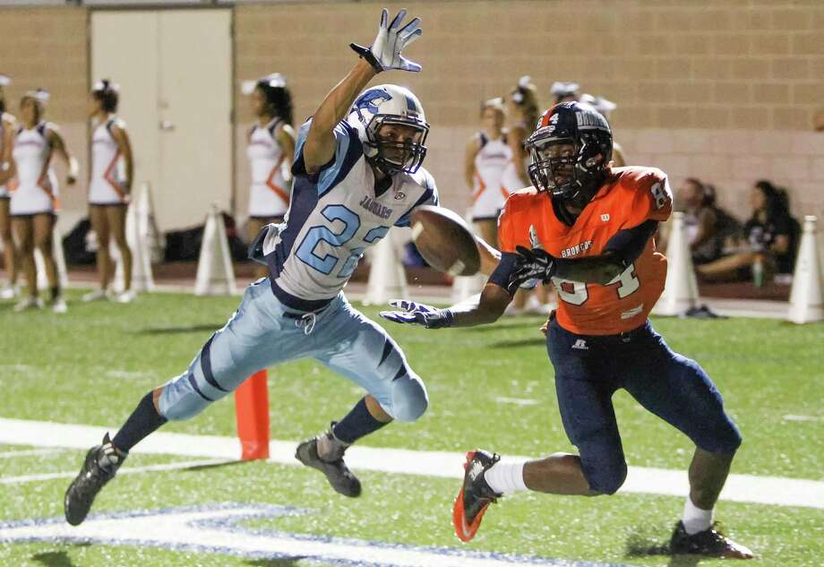 Larry Stephens, catching a touchdown against Johnson defensive back Elijah Loyd on Sept. 7 at Farris Stadium, leads Brandeis in receiving with 797 yards and 12 TDs. Photo: Marvin Pfeiffer / San Antonio Express-News