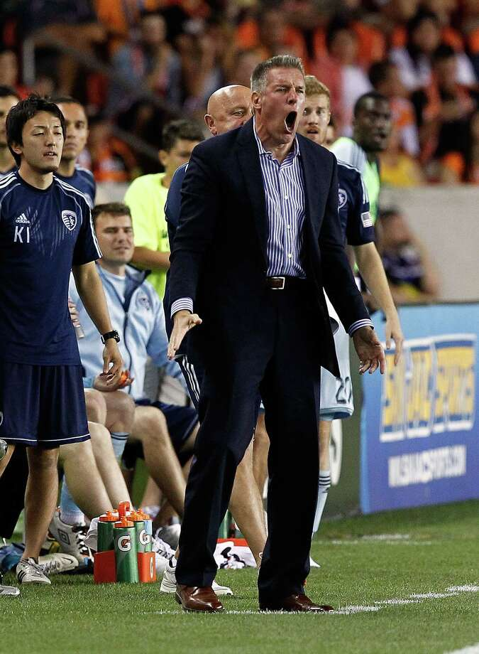 Sporting Kansas City coach Peter Vermes, left, met Dynamo coach Dominic Kinnear, right, in 1990 at a camp for the U.S. men's national team. Photo: Bob Levey, Freelance / ©2013 Bob Levey