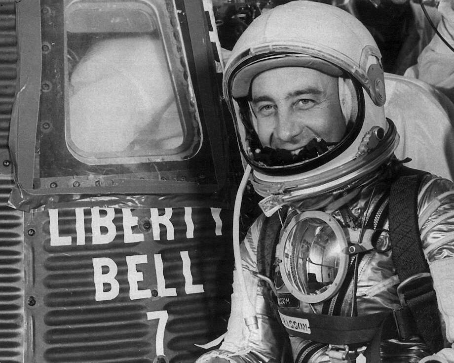 FILE- In this photo taken July 21, 1961, Astronaut Virgil I. Grissom is seen next to the space capsule Liberty Bell 7, for his departure from Cape Caneveral,  Fla. RR Auction of Amherst, N.H. is auctioning off a letter Grissom wrote to his mother, how he and five of his fellow Mercury 7 astronauts resented John Glenn for getting the nod to be the first American to orbit the earth. (AP Photo/Str/FILE) Photo: Anonymous, STR / AP