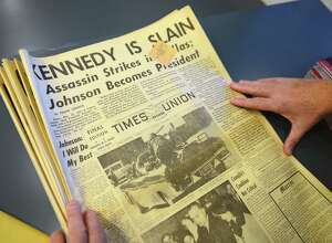 Harold Schmidt of Castleton, N.Y., displays his November 23, 1963 copy of the Times Union which reported the assassination of John F. Kennedy Wednesday, Nov. 20, 2013, at the Times Union in Colonie, N.Y. (Will Waldron/Times Union)