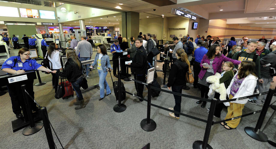 Crowds queue up at the security checkpoint during the Holiday travel crush at the Albany International Airport in Colonie November 24, 2010. (SKIP DICKSTEIN / TIMES UNION) Photo: Skip Dickstein / 2008