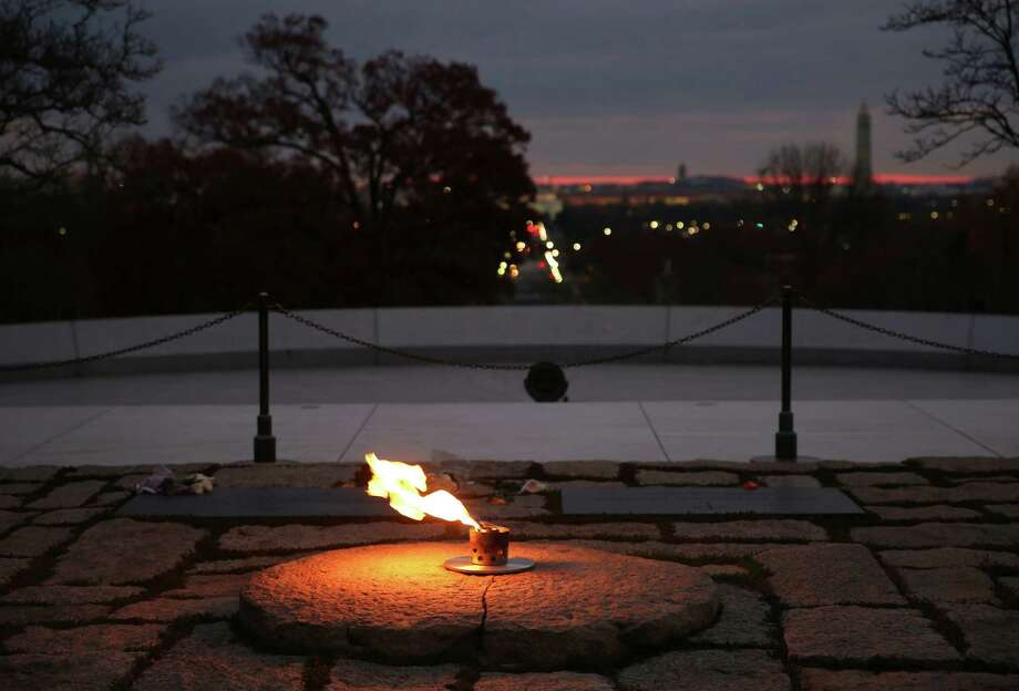 ARLINGTON, VA - NOVEMBER 19: The eternal flame burns at the gravesite of the 35th President of the United States John F. Kennedy, at Arlington National Cemetery, on November 19, 2013, in Arlington, Virginia. Friday November 22, 2013 will mark the 50th anniversary of President Kennedy's assassination during his visit to Dallas, Texas, in 1963.  (Photo by Mark Wilson/Getty Images) ORG XMIT: 450945595 Photo: Mark Wilson / 2013 Getty Images