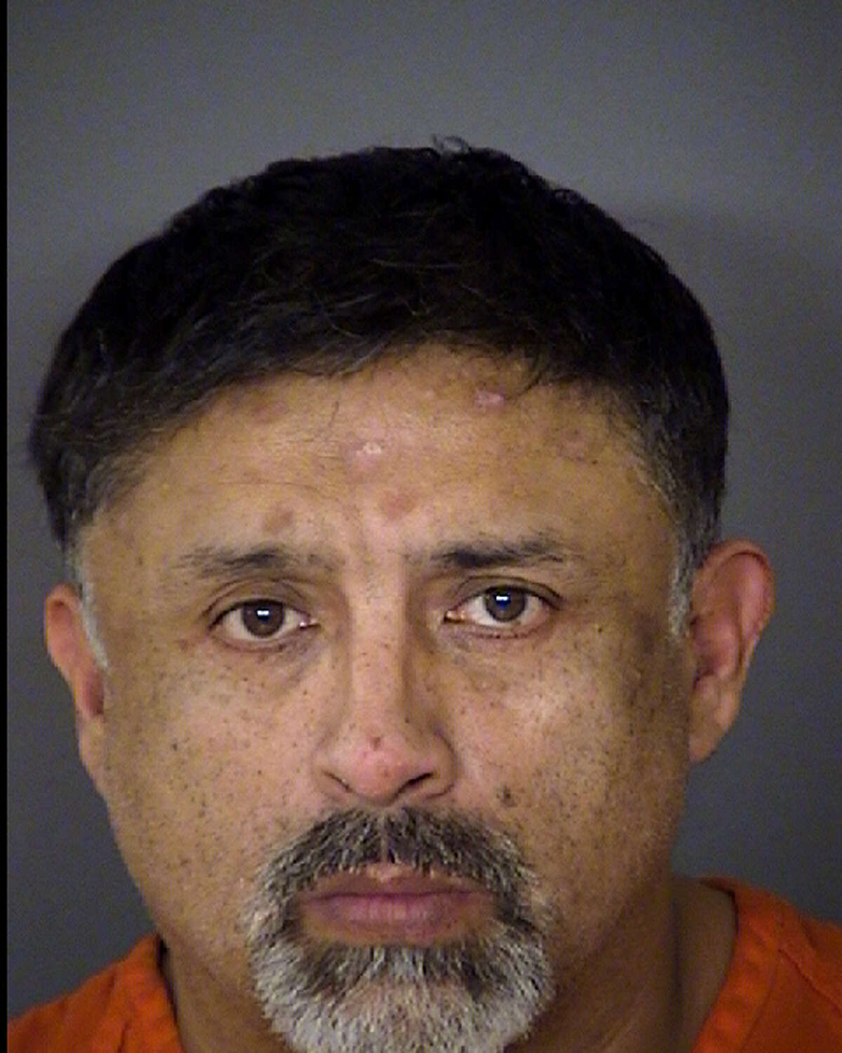 Joel Soto, seen in a Nov. 21, 2013 Bexar County Jail booking mug, was charged with arson of a vehicle, a second-degree felony punishable by up to 20 years in prison. Soto's 2-year-old grandson was found in the vehicle by first responders after the fire.