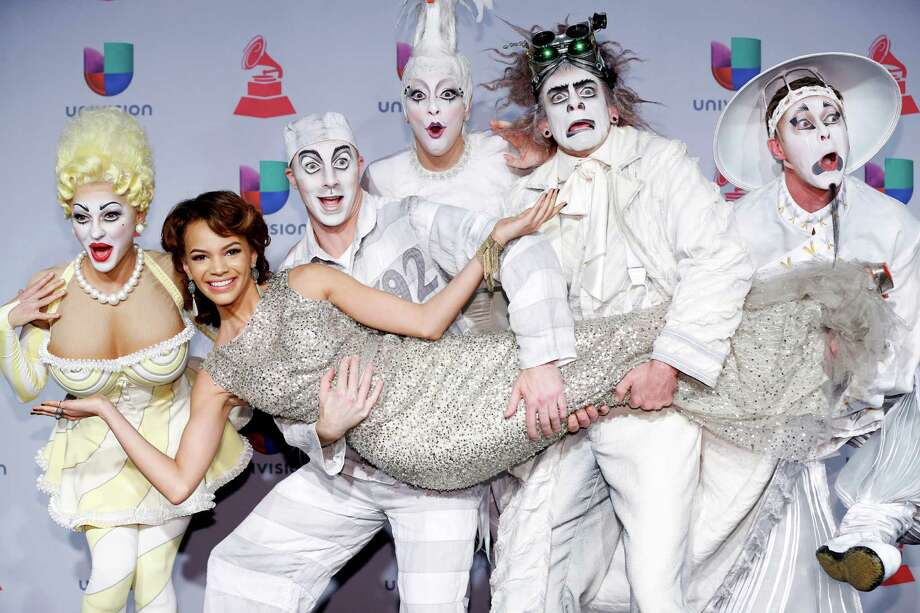 Leslie Grace, center, arrives with members of Cirque Du Soleil: Ka at the 14th Annual Latin Grammy Awards at the Mandalay Bay Hotel and Casino on Thursday, Nov. 21, 2013, in Las Vegas. (Photo by Eric Jamison/Invision/AP) Photo: Eric Jamison, INVL / Invision