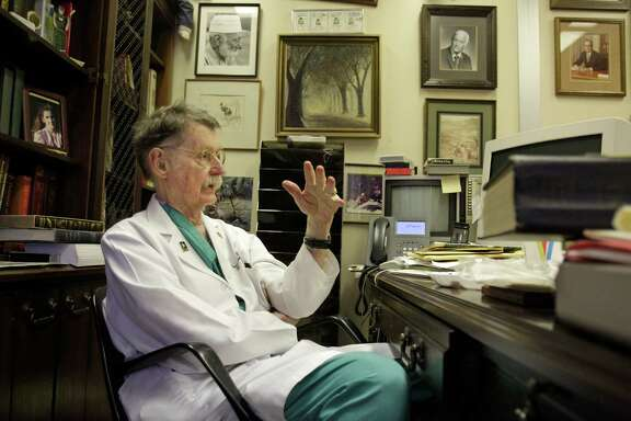 Dr. Red Duke talks in his office at UT medical school Tuesday, Nov. 19, 2013, in Houston. He was a resident at Parkland Hospital in Dallas in 1963 when President John F. Kennedy was taken to the hospital after being shot.