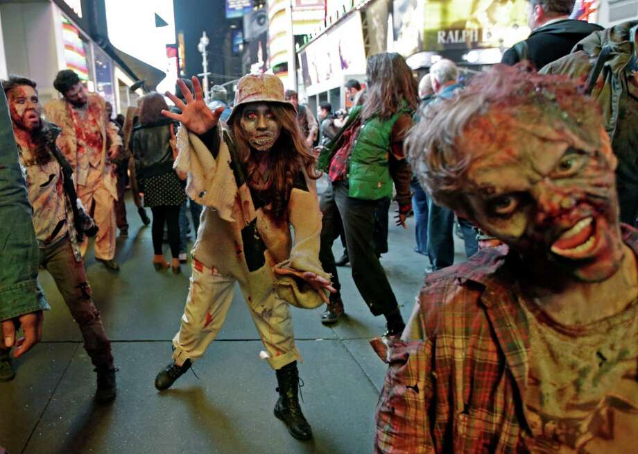 Xbox characters dressed as zombies parade through Times Square in advance of the midnight launch of Microsoft's Xbox One video game console, Thursday, Nov. 21, 2013, in New York. (AP Photo/Kathy Willens) Photo: Kathy Willens, Getty Images / AP