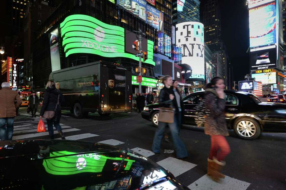 A giant video screen shows the logo for Microsoft's Xbox One game console November 21, 2013 in New York's Times Square. The Xbox One officially goes on sale at 12:01 am EST November 22. AFP PHOTO/Stan HONDASTAN HONDA/AFP/Getty Images Photo: STAN HONDA, Getty Images / AFP