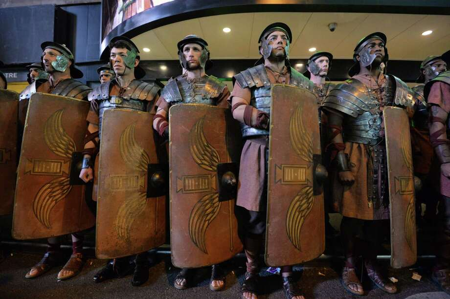 Men dressed as Roman soldiers as part of Microsoft's Xbox One game console launch event November 21, 2013 outside the Best Buy Theater in New York's Times Square. The Xbox One officially goes on sale at 12:01 am EST November 22. AFP PHOTO/Stan HONDASTAN HONDA/AFP/Getty Images Photo: STAN HONDA, Getty Images / AFP