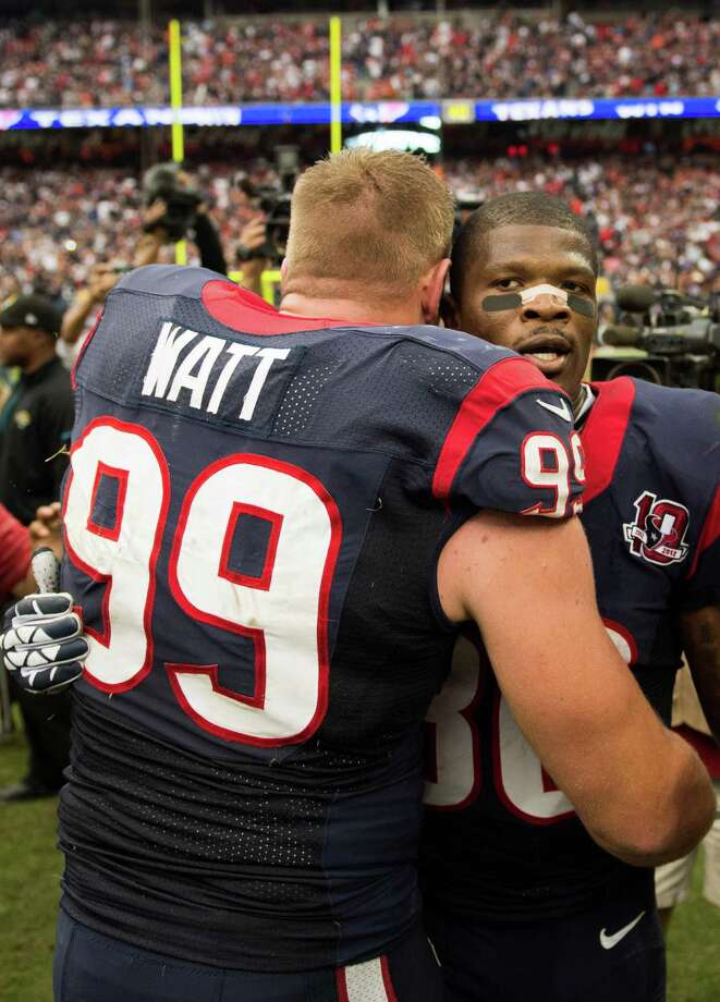 Texans wide receiver Andre Johnson and defensive end J.J. Watt continue to lead by example even though the team is in the midst of an eight-game losing streak. Photo: Smiley N. Pool, Staff / © 2012  Houston Chronicle