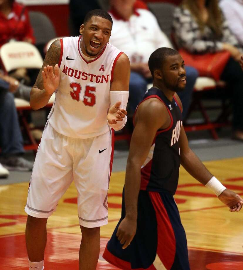 Houston's TaShawn Thomas, left, celebrates a penalty called on Howard as Howard's James Miller walks past during the first half of an NCAA college basketball game, Thursday, November 21, 2013, at Hofheinz Pavilion in Houston. (Photo: Eric Christian Smith/For the Chronicle) Photo: For The Chronicle