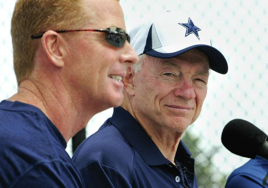 Cowboys owner Jerry Jones (right), pictured with coach Jason Garrett during training camp, credited Garrett with having the team near the top of the NFC East. At 5-5, Dallas enters its game against the Giants a half-game behind first-place Philadelphia. Photo: Gus Ruelas / Associated Press