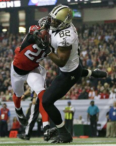 Saints tight end Benjamin Watson (82) pulls down Drew Brees' second touchdown pass against the Falcons. Photo: David Goldman, STF / AP