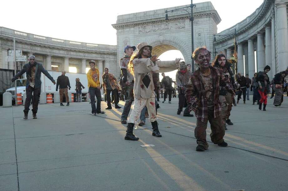 �Dead Rising 3� zombies cross over Manhattan Bridge as they head to Best Buy Theater in Times Square for the launch of Xbox One on Thursday, November 21, 2013.