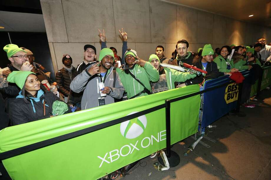 Fans celebrate the launch of Xbox One outside of the Best Buy Theater in Times Square on Thursday, November 21, 2013. (Photo by Jason DeCrow/Invision for Microsoft/AP Images) Photo: Jason DeCrow, AP Photo / Invision