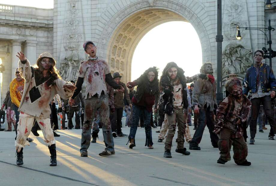 IMAGE DISTRIBUTED FOR MICROSOFT - �Dead Rising 3� zombies cross over Manhattan Bridge as they head to Best Buy Theater in Times Square for the launch of Xbox One on Thursday, November 21, 2013. (Photo by Diane Bondareff/Invision for Microsoft/AP Images) Photo: Diane Bondareff, AP Photo / Invision