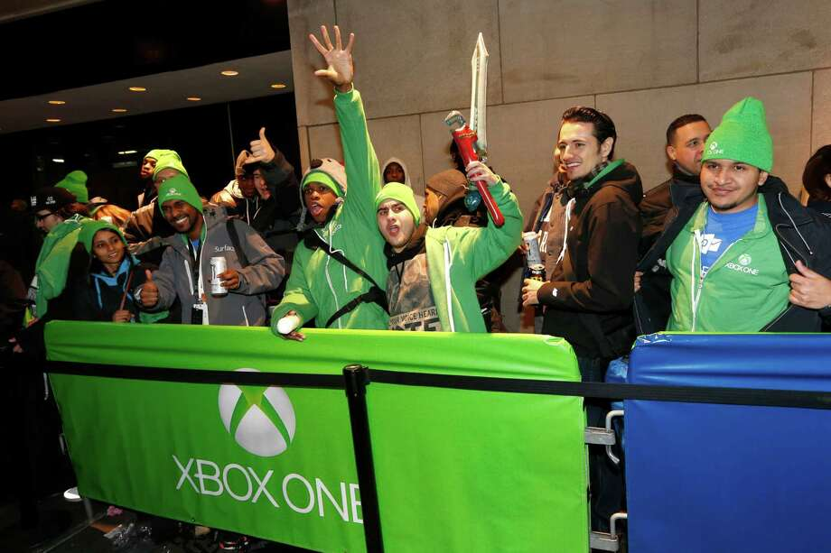 IMAGE DISTRIBUTED FOR MICROSOFT - Fans celebrate the launch of Xbox One outside of the Best Buy Theater in Times Square on Thursday, November 21, 2013. (Photo by Jason DeCrow/Invision for Microsoft/AP Images) Photo: Jason DeCrow, AP Photo / Invision