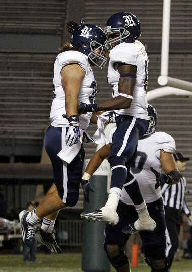 Rice running back Luke Turner (35) celebrates with Rice wide receiver Donte Moore (81) after scoring