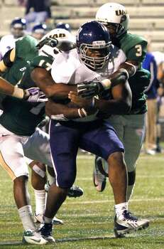 Rice running back Charles Ross (12) carries the ball in for a touchdown. Photo: Butch Dill, Associated Press