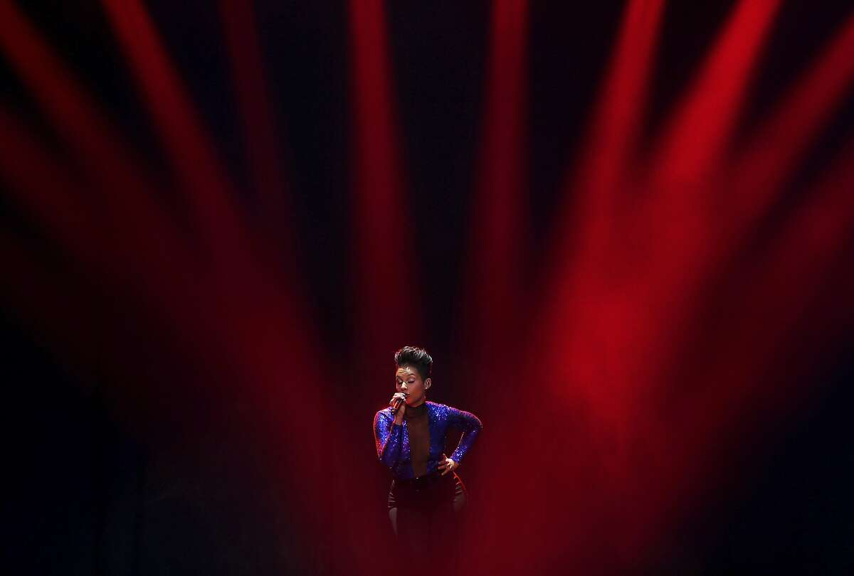 In this Wednesday, Nov. 20, 2013 photo, American singer Alicia Keys performs on stage during her world tour concert