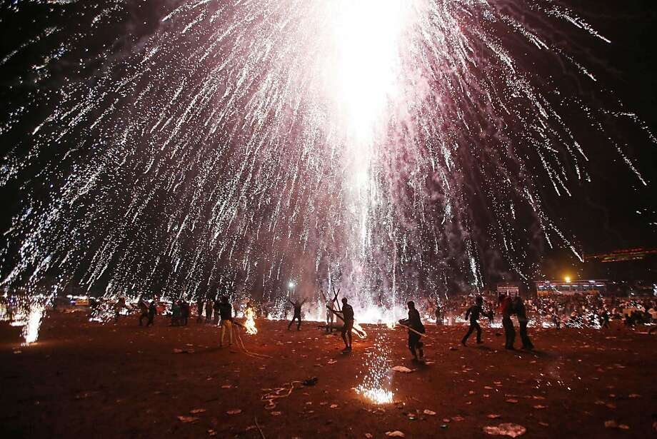 Myanmar's annual blast: In Taunggyi, Myanmar, fireworks explode overhead during the Tazaungdaing Lighting Festival. Tens of thousands gather every year for the celebration, during which balloons lift fireworks or lanterns into the night sky. Photo: Ye Aung Thu, AFP/Getty Images