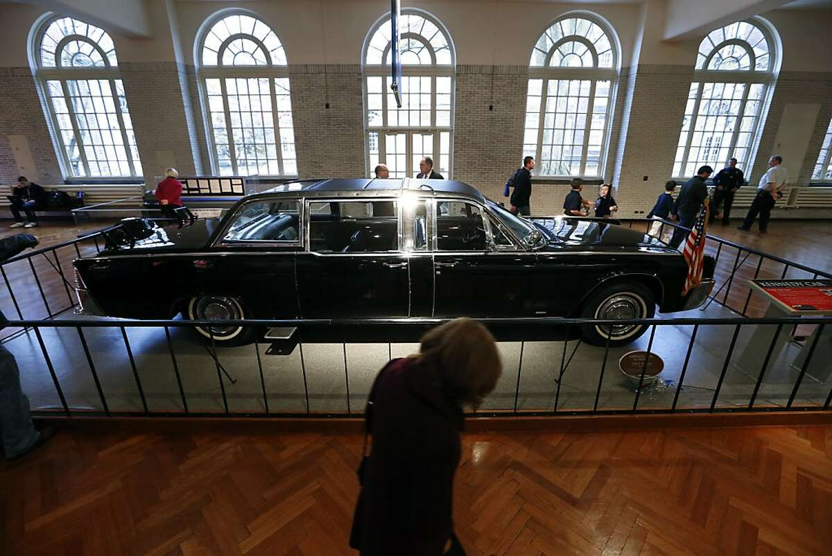 Spectators view the presidential limousine of John F. Kennedy that is on display at The Henry Ford museum in Dearborn, Mich., Thursday, Nov. 21, 2013. Friday marks the 50th anniversary of the president's assassination in Dallas. (AP Photo/Paul Sancya)