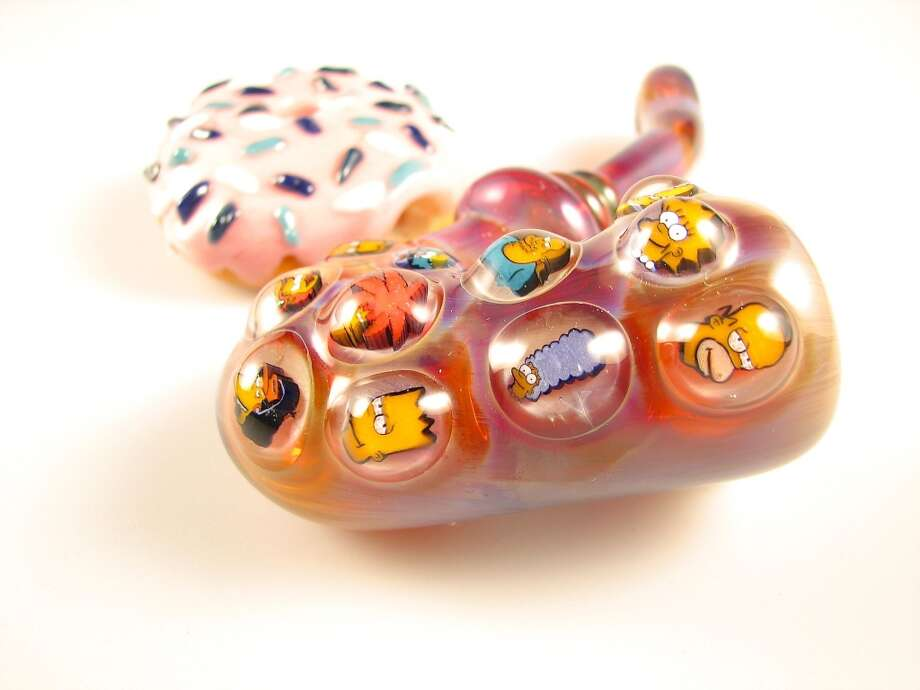 "Josh Ford's Malachi Simpsons millifiori ""sherlock"" pipe colored in Loki's lipstick ($700) pairs well with KGBglass' $100 donut pipe - the healthiest donut in the world. Mmm, donuts. Photo: David Downs"