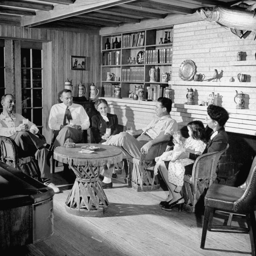 Texan Roy Hofheinz (CR) sitting with his family at home.