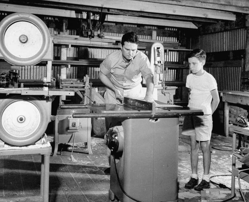 Texan Roy Hofheinz working in his machine shop.