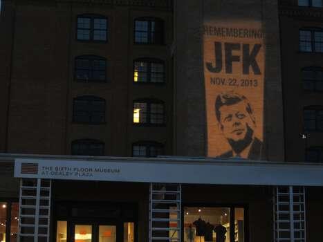A projected image lights up a wall in Dallas early Friday, Nov. 22, 2013. Photo: David Hendricks/San Antonio Express-News