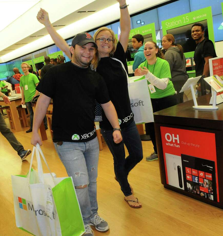Excited fans show off their new Xbox One after buyingt at midnight from the Microsoft retail store at the Florida Mall on Friday in Orlando. (Photo by Gerardo Mora/Getty Images for Microsoft) Photo: Gerardo Mora, Ap/getty / 2013 Gerardo Mora