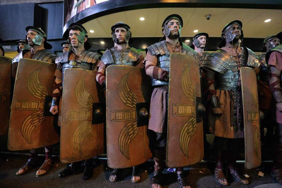Men dressed as Roman soldiers as part of Microsoft's Xbox One game console launch event November 21, 2013 outside the Best Buy Theater in New York's Times Square.  Photo: STAN HONDA, Ap/getty / 2013 AFP
