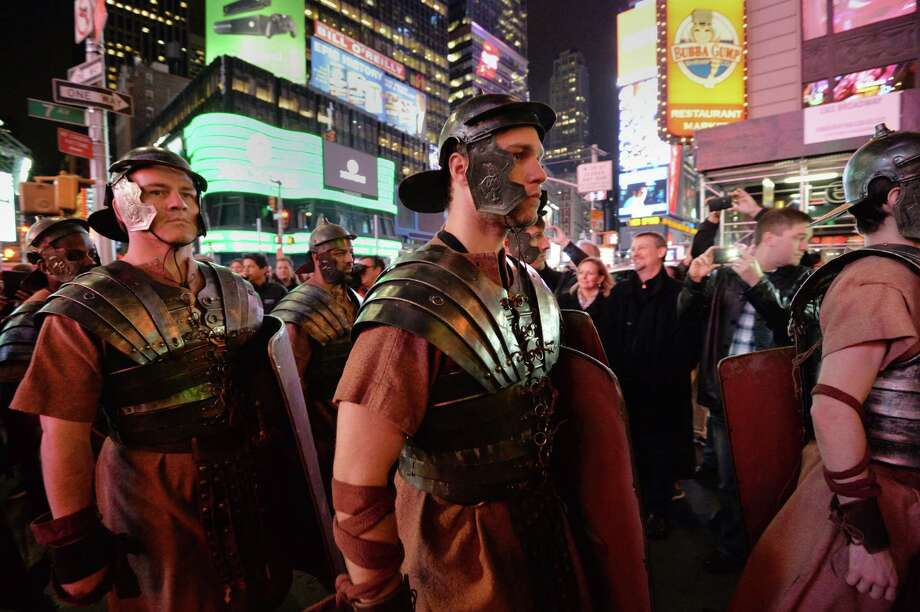 Men dressed as Roman soldiers as part of Microsoft's Xbox One game console launch event Thursday outside the Best Buy Theater in New York's Times Square. Photo: STAN HONDA, Ap/getty / 2013 AFP