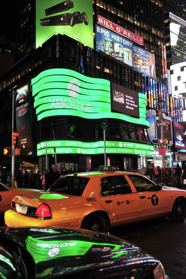 A giant video screen shows the logo for Microsoft's Xbox One game console Thursday in New York's Times Square. The Xbox One officially went on sale 12:01 am EST Friday. Photo: STAN HONDA, Ap/getty / 2013 AFP