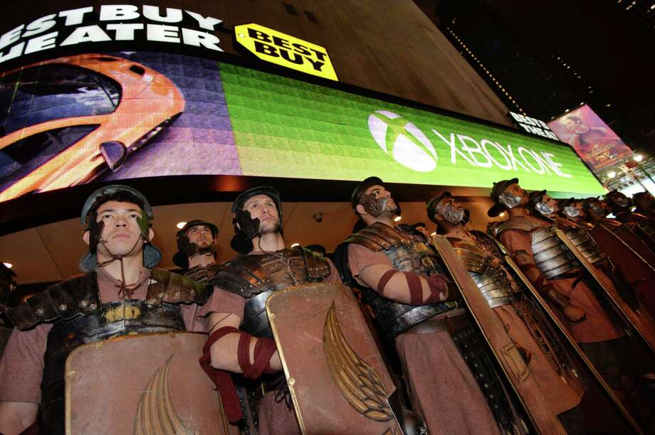 Hey, centurion, got game? Men dressed as Roman soldiers as part of Microsoft's Xbox One game console launch event Thursdayoutside the Best Buy Theater in New York's Times Square. The Xbox One officially went on sale at 12:01 am EST Friday. Photo: STAN HONDA, Ap/getty / 2013 AFP