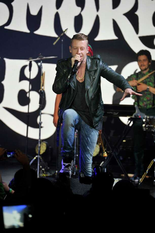 Macklemore performs on stage at the Xbox One Countdown to Launch event at the Best Buy Theater in Times Square on Thursday. Image distributed for Microsoft. Photo: Charles Sykes, Ap/getty / AP2013