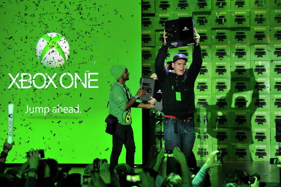 The first fans in the U.S. get their hands on Xbox One at the Best Buy Theater in Times Square on Friday. Image distributed for Microsoft.  Photo: Charles Sykes, Ap/getty / AP2013