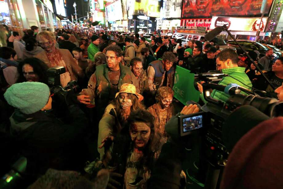 "The undead play games, too. Zombies from Xbox One exclusive title ""Dead Rising 3"" arrive at Best Buy Theater in Times Square for the launch of Xbox One on Thursday. Image distributed for Microsoft Photo: Jason DeCrow, Ap/getty / AP2013"